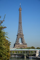 Metro crossing Bir-hakeim bridge with  Eiffel Tower in background , Paris, France