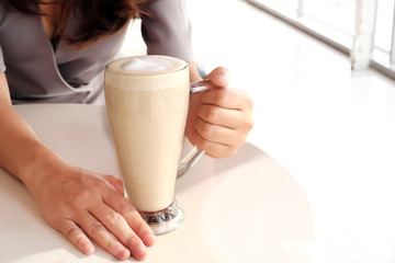 Hot coffee in a tall glass