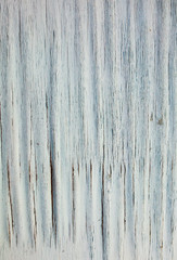 Peeling white paint pattern on old wooden background. Whitewash texture of the vintage house in the village.