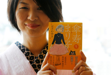 Yuki Ozawa, the comic book author of Sanju Mariko, poses with her comic book during an interview with Reuters in Tokyo