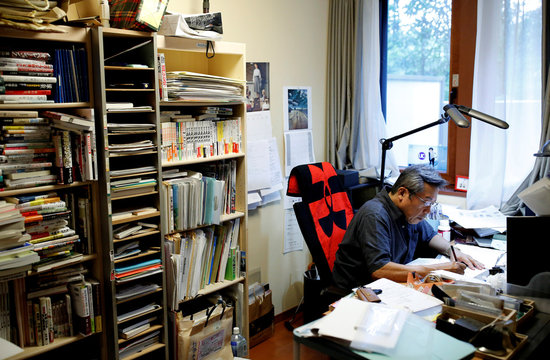 Kenshi Hirokane, the comic book author of the Kosaku Shima and Like Shooting Stars in the Twilight series, works at his studio in Tokyo
