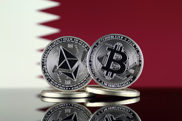 Physical version of Ethereum (ETH), Bitcoin (BTC) and Qatar Flag. 2 largest cryptocurrencies in terms of market capitalization.