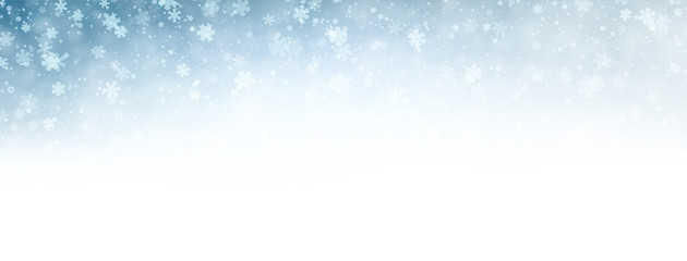Blue blurred winter banner with snow pattern.