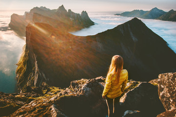 Woman standing alone in sunset mountains hiking outdoor active vacations traveling adventure lifestyle enjoying breathtaking aerial view landscape