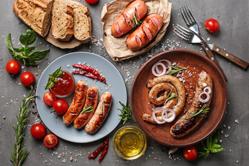 Plates with tasty fried sausages on table, top view