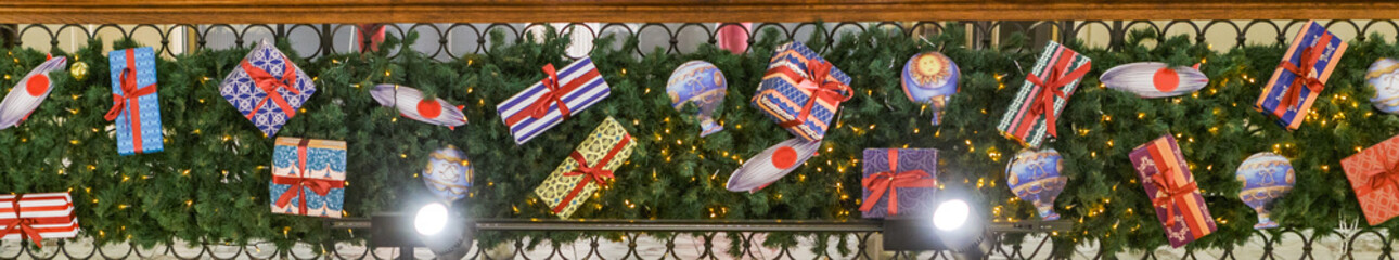 Photo of decorated with boxes with gifts of spruce branches