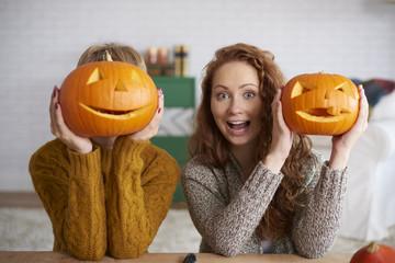 Shouting women showing halloween pumpkins