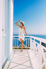 Summer tourist woman posing on the Mediterranean balcony