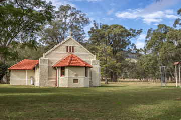Country stone church in rural landscape setting