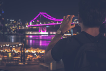 Man taking picture of beautiful cityscape