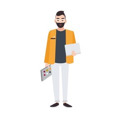 Graphic, web or interior designer or creative worker holding color palette and laptop. Smiling male cartoon character isolated on white background. Colored vector illustration in flat style.