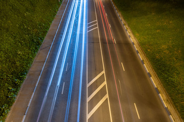 Night highway with car light streaks. Night light painting stripes. Long exposure photography. Copy space