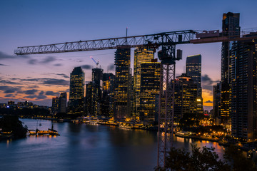 Colorful illuminated metropolis in twilight Fototapete
