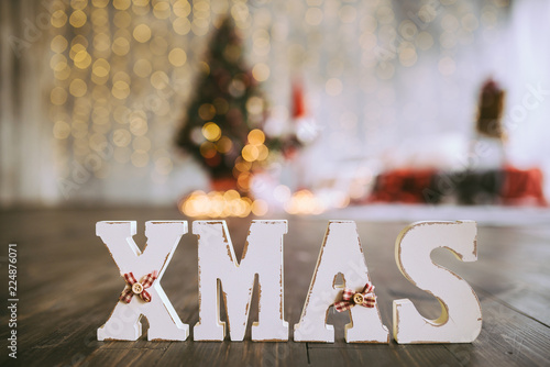 Wooden Letters Xmas On The Christmas Tree Background Stock Photo