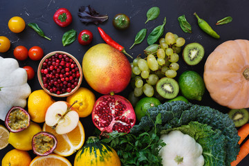 Colorful organic raw fruits and vegetables from the farmer's market, dieting and nutrition concept