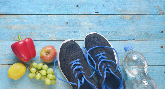 Getting fit and reducing weight for the springtime, pair of runners and healthy food,free copy space,flat lay