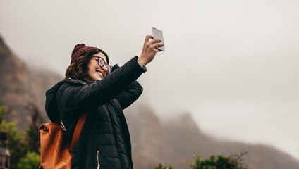 Woman on winter vacation taking a selfie