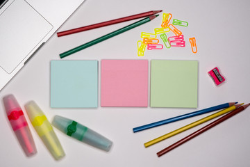 Colorful sticky notes and stationery on office desctop. Text space