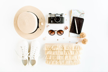 Wall Mural - Woman fashion travel. Straw hat, bag with accessories, sneakers, retro camera, sunglasses. Flat lay. Top view
