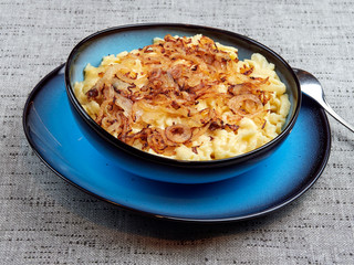 "Traditional Swabian ""Käsespätzle"" - a dish of egg and flour noodles with grated cheese and fried onions. Also spelled kaesespaetzle"