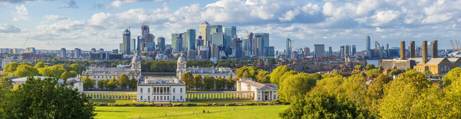 ondon, England, Panoramic Skyline View Of Greenwich College and Canary Wharf At Golden Hour Sunset With Blue Sky And Clouds