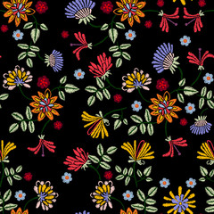 Embroidery repeat pattern with meadow flowers. Vector seamless floral patch for clothing design.