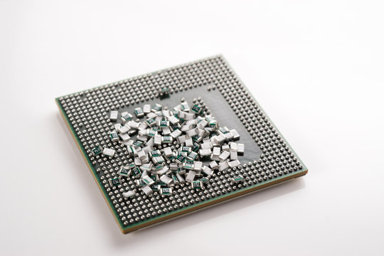 Scattered SMD Chip Resistor / Ceramic Capacitor and a glass bottle on white isolated background