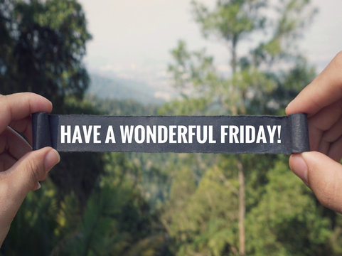 Motivational and inspirational greeting - 'Have a wonderful Friday' written on a black paper. Vintage styled background.