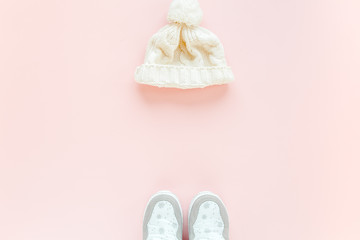 White women winter boots isolated on pink background. Flat lay, top view trendy fashion feminine background. Beauty blog concept. Fashion blog look.