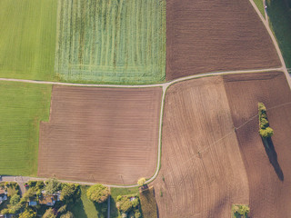 Aerial view of plowed fields in rural landscape in Switzerland