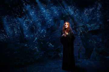 Fototapete - Witch in night forest