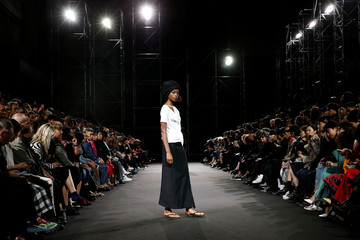 A model presents a creation by designer Yohji Yamamoto as part of his Spring/Summer 2019 women's ready-to-wear collection show during Paris Fashion Week in Paris