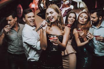 Selfie. Sing and Drink. Black Dress. Smile. Club.