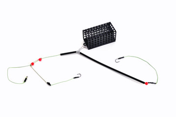 fishing trough, fishing hooks and fishing line, accessories for bottom fishing on a white background close-up