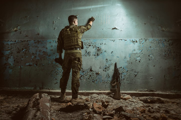 the people in uniform with weapons in the ruins Wall mural