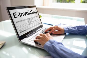 Businesswoman Preparing E-invoicing Bill On Laptop