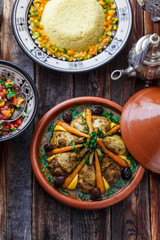 Close view of chicken tajine with lemon and olives