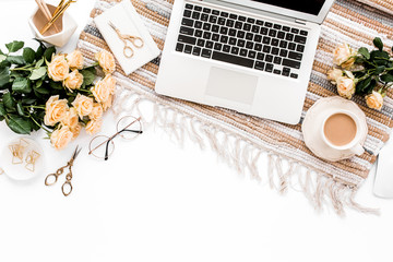 Female workspace with laptop, roses flowers bouquet, golden accessories, diary, computer, glasses on white background. Flat lay women's office desk. Top view feminine background.