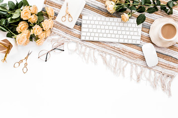 Female workspace with roses flowers bouquet, golden accessories, diary, glasses on white background. Flat lay women's office desk. Top view feminine background.