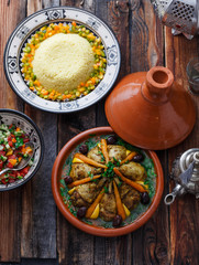 Morrocan party food tajine, salad, couscous, tea, top view.