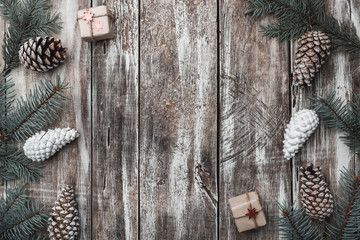 Old wooden background. Fir branches, cones. Christmas Fellowship, New Year and Xmas. Space for Santa's message and holidays. Gifts.Holiday card. Xmas and Happy New Year composition. Flat lay, top view