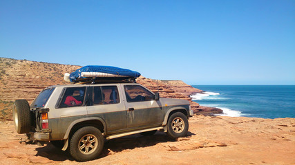 Off-road verhicle on a lonely costline beach