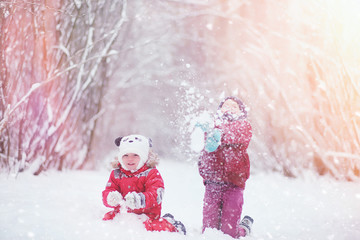 Young family with children are walking in the winter park. Winte