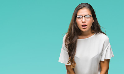 Young beautiful arab woman wearing glasses over isolated background afraid and shocked with surprise expression, fear and excited face.