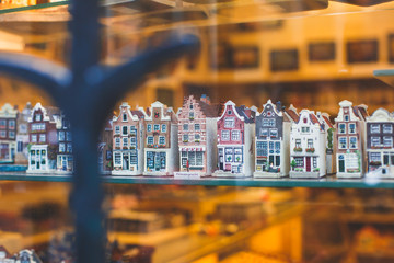Traditional souvenirs from Amsterdam rows of Delftware porcelain Dutch style houses, Shop window, Netherlands