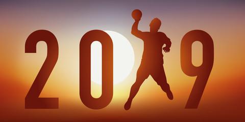 Carte de vœux 2019 sur le thème du handball, avec un handballeur en pleine action, qui tire en extention pour un tir au but