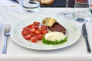 Burrata cheese with cherry tomatoes and anchovies from the Sea