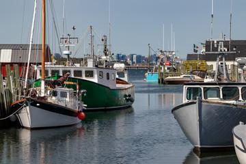 fishing boats in autumn sunshine dockside