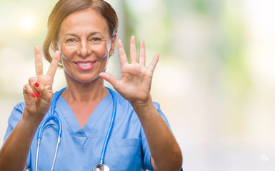 Middle age senior nurse doctor woman over isolated background showing and pointing up with fingers number seven while smiling confident and happy.