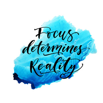 Focus determines reality phrase on watercolor vector shape. Modern brush calligraphy. Vector illustration.